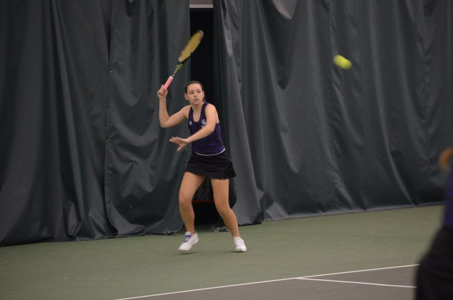 Sophomore Kendra Kappes volleys the ball during a doubles match against Upper Iowa University on Saturday, March 17 at the Winona Tennis Center, the Warriors won 8-1.