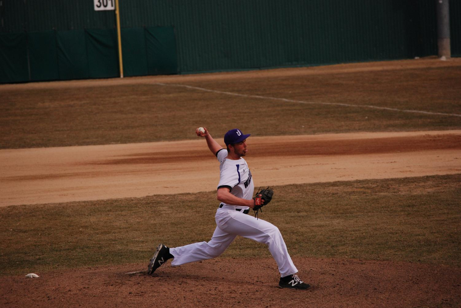 First-year Austin Savary throws a pitch against Upper Iowa University during a doubleheader on Friday, April 12 at Loughrey Field, the Warriors won both games 13-2 and 7-1.