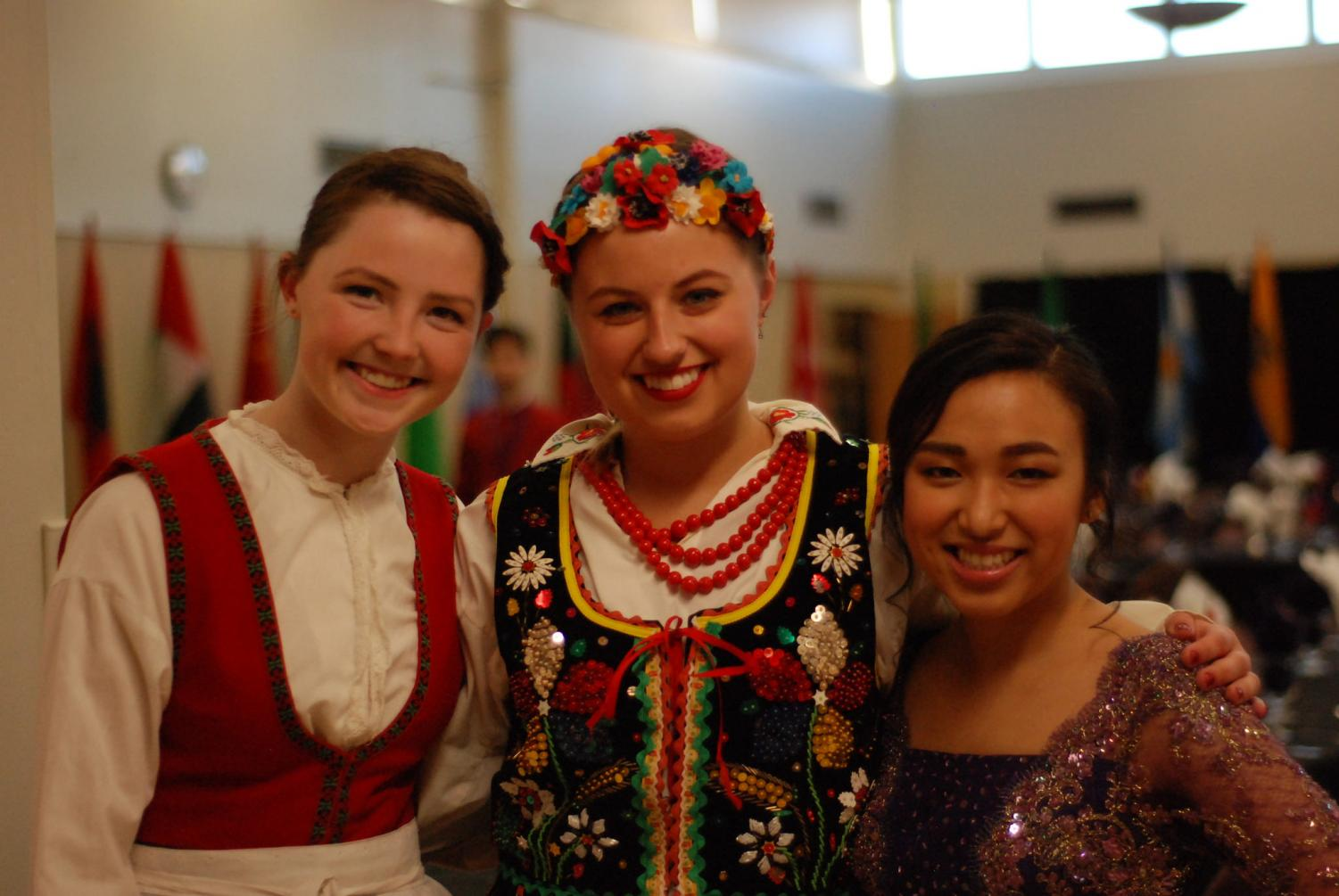 Left to right: first-year Anna Millerhagen, sophomore Nina Horbik and sophomore Nutsovanary Puy in traditional dress at Winona State University's 31st annual International Dinner on Saturday, April 7. Hosted by the International Club in East Hall, the dinner is a celebration for on-campus international diversity with cultural foods, performances and prizes. Tickets are open to students and community members to see Winona State students showcase their different cultures.