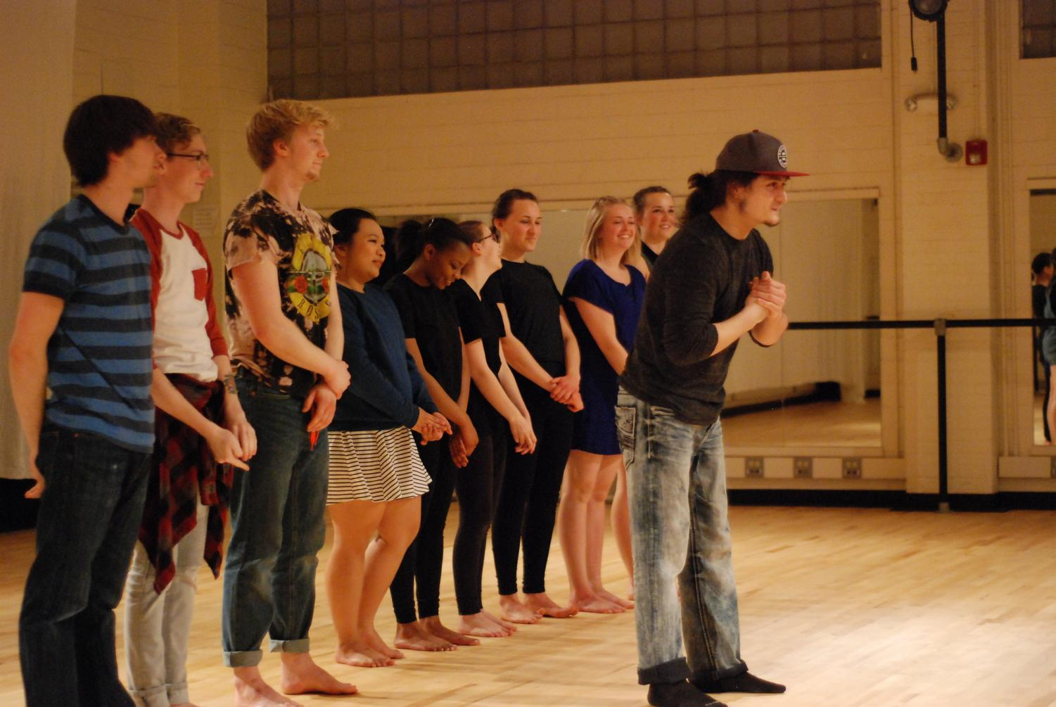 "Senior Nick Garcia bows with the cast of ""Nick's Movement Capstone"" at the end of the final performance on Thursday, April 5 in the Memorial 300 dance studio. Garcia's capstone marks the end of a semester long project which was inspired by the future and his audition plans after graduation."