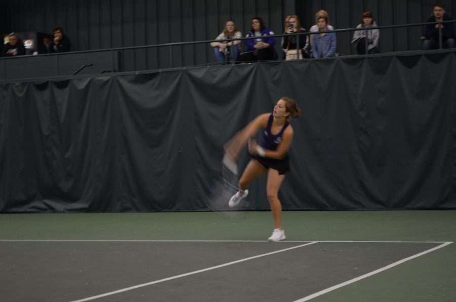 Senior+Rachel+Gantz+hits+the+ball+back+towards+Upper+Iowa+on+Saturday%2C+March+17+at+the+Winona+Tennis+Center.+The+Warriors+played+against+the+University+of+Mary+and+Minnesota+State+University+Moorhead+this+weekend%2C+winning+both+games+7-2+and+6-3.