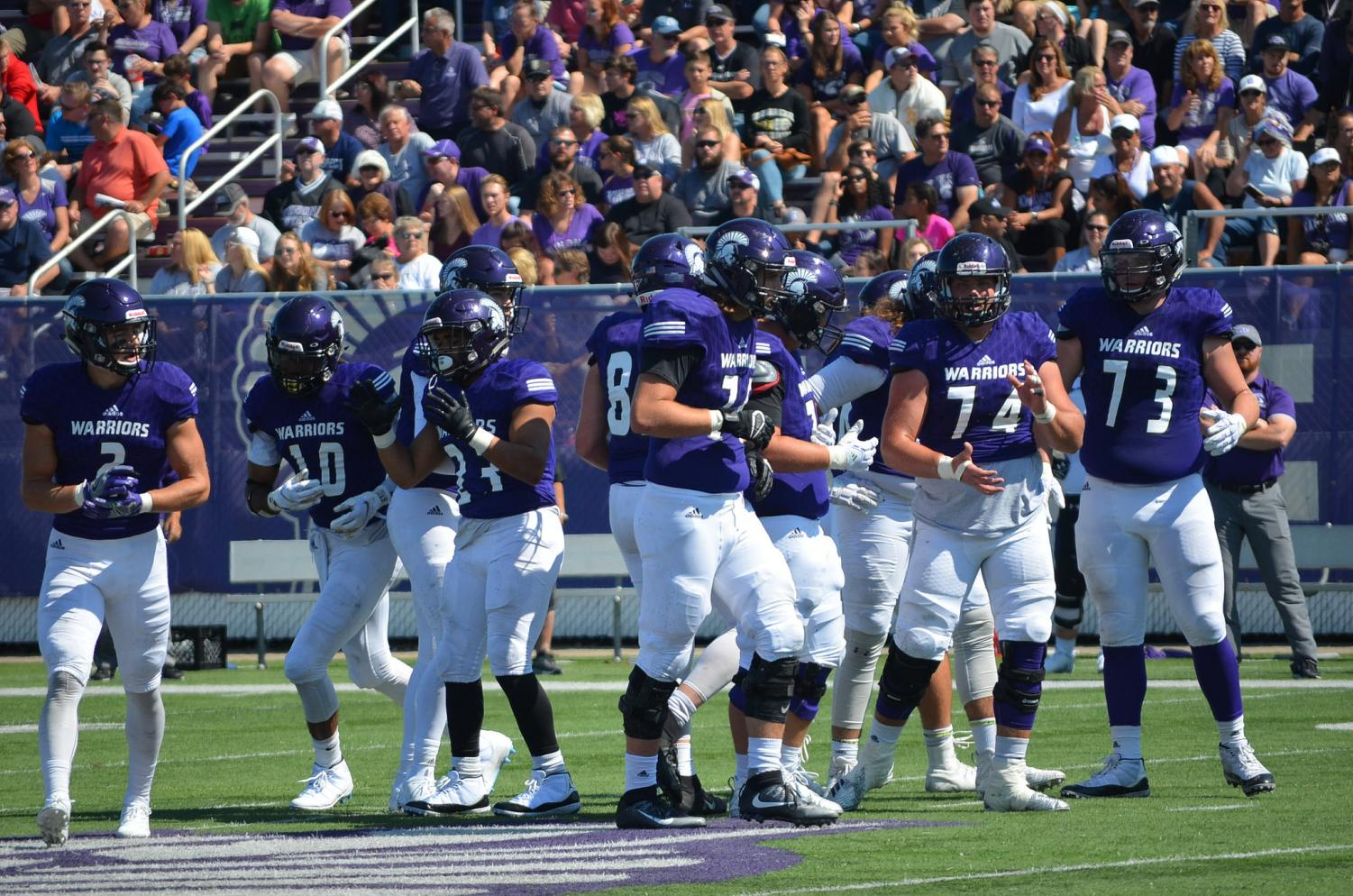 Members of the Winona State football team break from a huddle during the first home game of the season against the University of Sioux Falls South Dakota on Saturday, Sept. 8 in the Altra Credit Federal Union Stadium. The Warriors came out with a second win for the season, beating the Cougars 16-15.