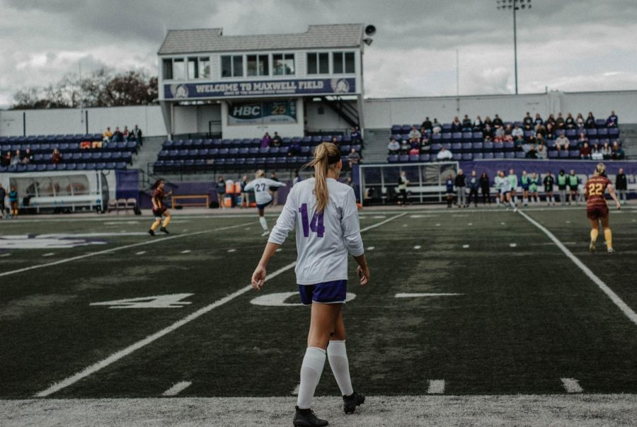 Senior defender Mackenzie Challoner walks onto the field during a game against the University of Minnesota Crookston on Friday, Sept. 21 in the Altra Federal Credit Union Stadium. The Warriors and the Golden Eagles tied the game with a score of 1-1.