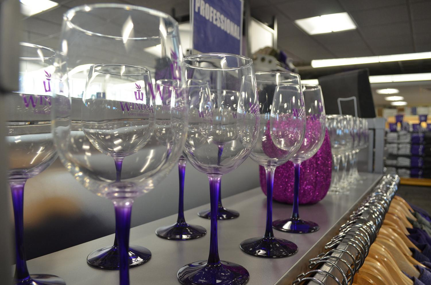 Winona State University wine glasses are set on in the Winona State bookstore. Winona State, which is a dry campus, sells multiple drinkware items which are typically used for alcoholic beverages.
