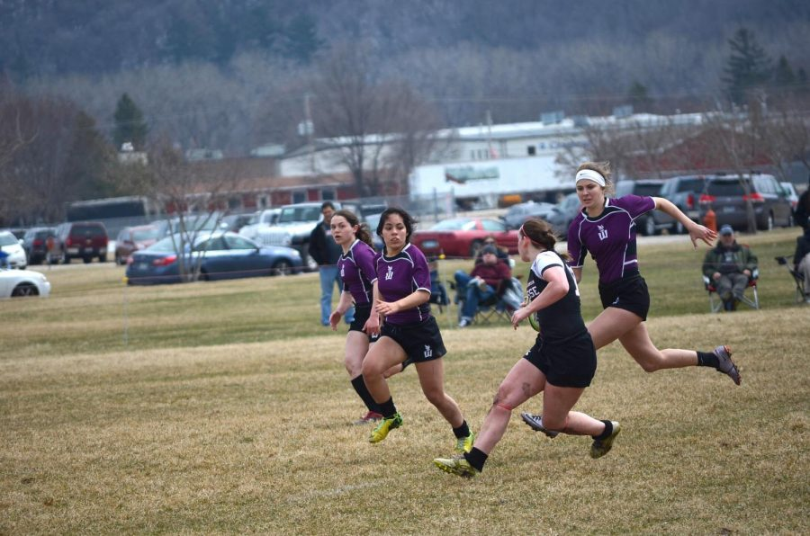 Left to right: Caitlyn Deetz, Diana Alvarado, and Annika Culver chase down and get ready to tackle a player from La Crosse at a match on Saturday, April 21 at Southeast Technical College, the Black Katts won 67-21.