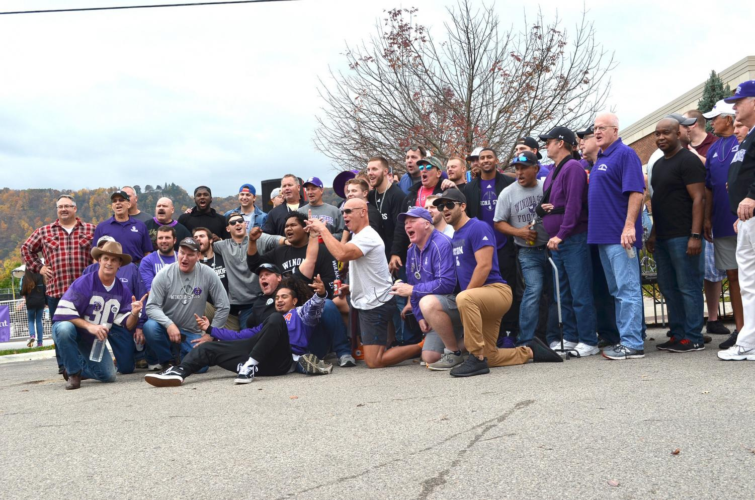 Winona State alumni and former members of the football team gather together for a photo before the 2017 Homecoming game during the Game Day Experience. Events like the Game Day Experience are subject to an exception from the Winona State dry campus policy after some paperwork.