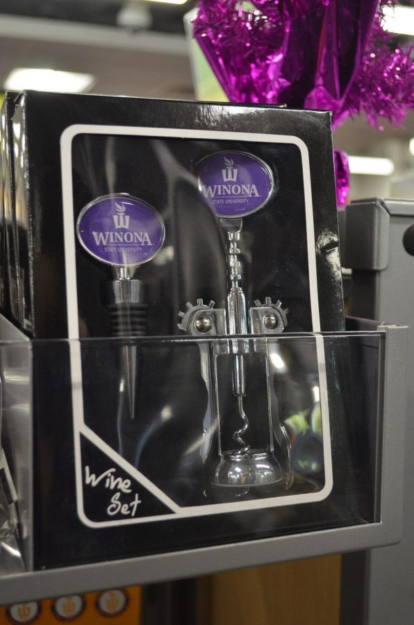"""Winona State University wine sets are set on display in the """"giftware"""" section of the Winona State bookstore. Winona State, which is a dry campus, sells multiple drinkware items which are typically used for alcoholic beverages."""