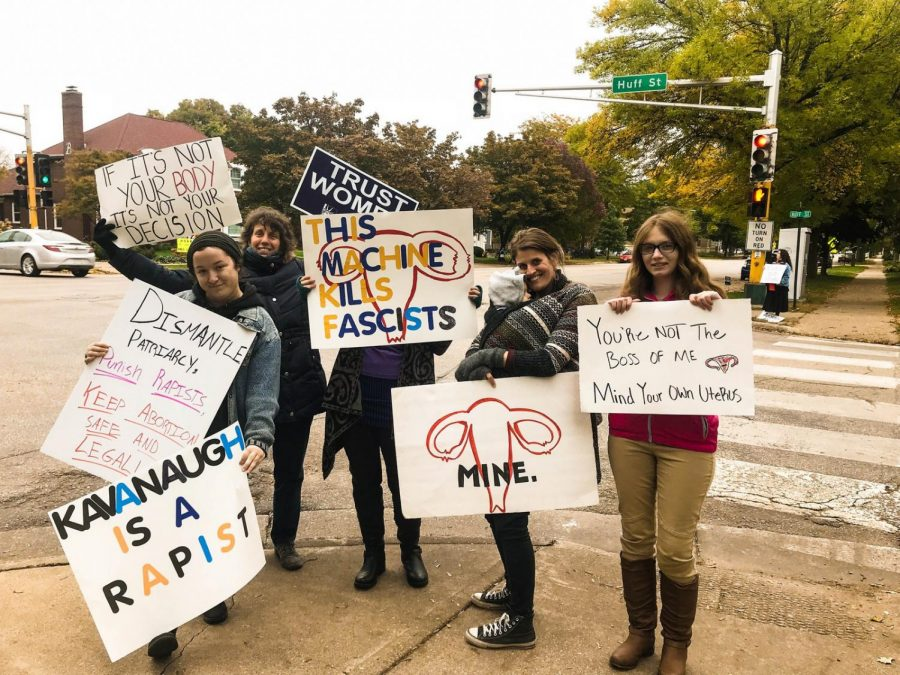 Members of the community and FORGE stand at the intersection of Huff and Broadway to counter protest Winona Life Chain, a local anti-abortion organization on Sunday, Oct. 7.