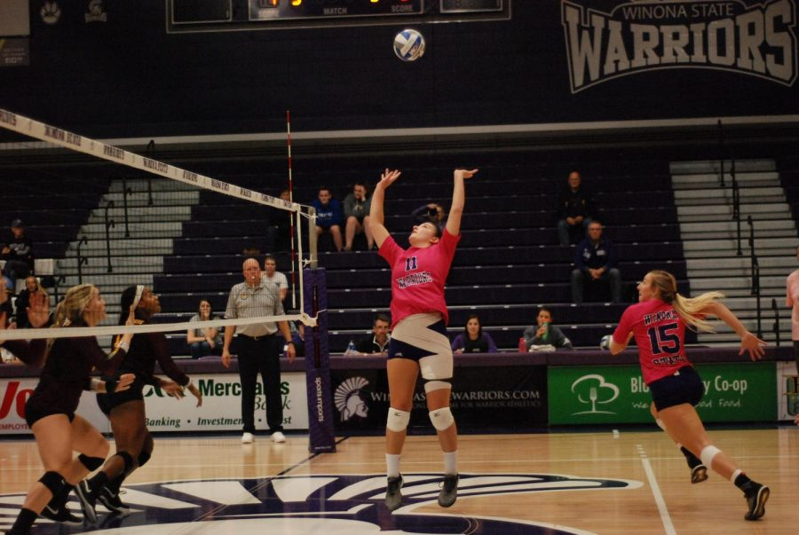 Sophomore Bre Maloney reaches up to spike the ball against The University of Minnesota Crookston in McCown Gymnasium on Friday, October 19. The Warriors won 3-0.