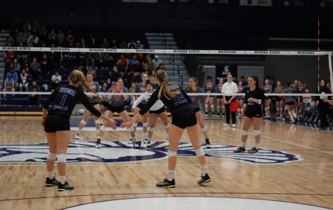Volleyball splits homecoming matches
