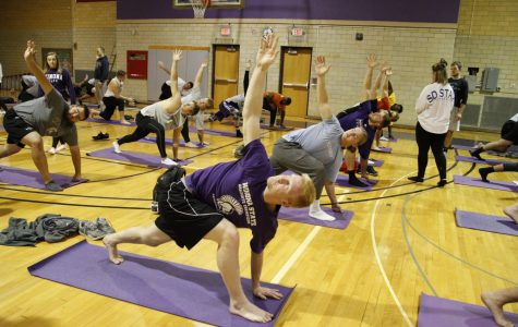 Members of the Winona State football team participate in the Restorative Flow Movement Pattern program which was designed to help athletes recover from hard practices or injuries.