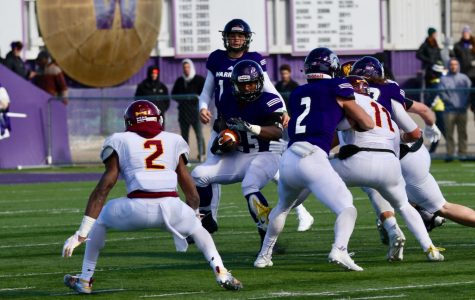 Senior running back Eric Birth attempts to weave around players from the University of Minnesota Duluth on Oct. 20 at Altra Federal Credit Union Stadium, Birth has played for Winona State all four years and chose to remain in his hometown for college.
