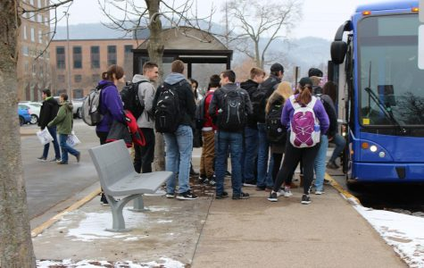 Winona State University students wait in line to get on the shuttle to west campus. There have been some inconsistencies with the shuttle system that have been inconveniencing students.