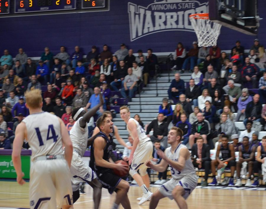 Junior guard Caleb Wagner charges toward the net in an attempt on basket during a game against the University of Sioux Falls on Saturday, Jan. 26 in McCown Gymnasium. The Warriors finished off the weekend with two wins, scoring 85-67 against Southwest Minnesota State University on Friday and 80-77  against the Cougars.