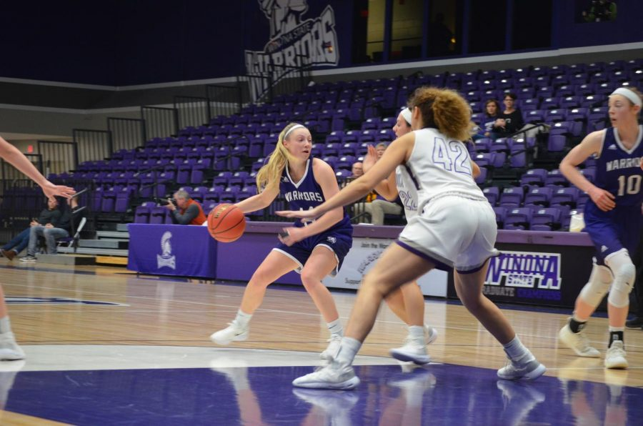 Sophomore+guard+Emily+Kieck+looks+to+pass+the+ball+to+a+teammate+during+a+game+against+the+University+of+Sioux+Falls+on+Saturday%2C+January+26.+The+team+took+away+two+wins+against+Southwest+Minnesota+State+%0AUniversity+and+Sioux+Falls+scoring+71-69+and+64-50%2C+bringing+their+season+record+to+10+wins+and+eight+losses.+