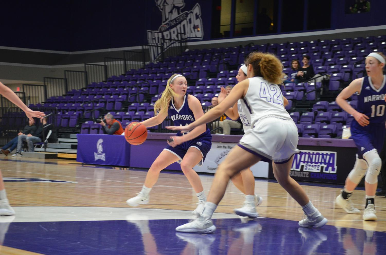 Sophomore guard Emily Kieck looks to pass the ball to a teammate during a game against the University of Sioux Falls on Saturday, January 26. The team took away two wins against Southwest Minnesota State  University and Sioux Falls scoring 71-69 and 64-50, bringing their season record to 10 wins and eight losses.