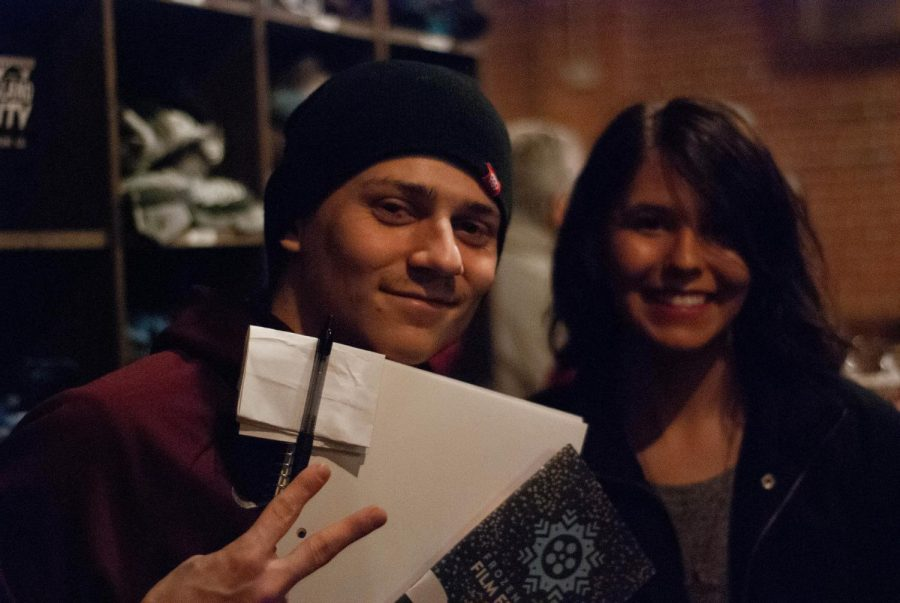Winona State Sophomore Kelly Hagberg (right) attends the Frozen River Film Festival viewing at Island City Brewery in downtown Winona with her friend Ross on Friday, Feb. 8.