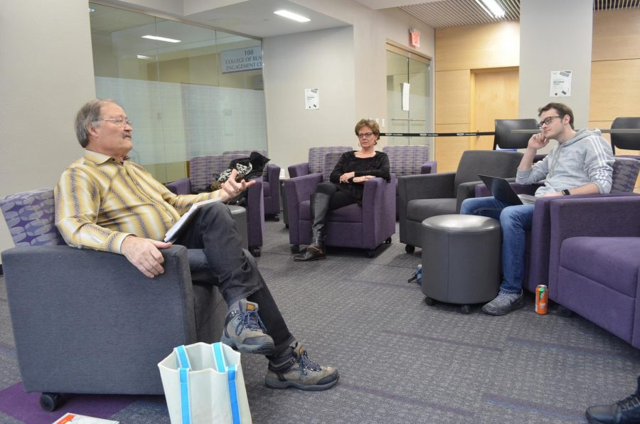 """Robert Junghans speaks to a small group of students with his wife, Kathy, in Somsen Hall's Business Engagement Center on Saturday, Feb. 23. Junghans spoke about his journey publishing his first book """"Cloud Warriors""""."""