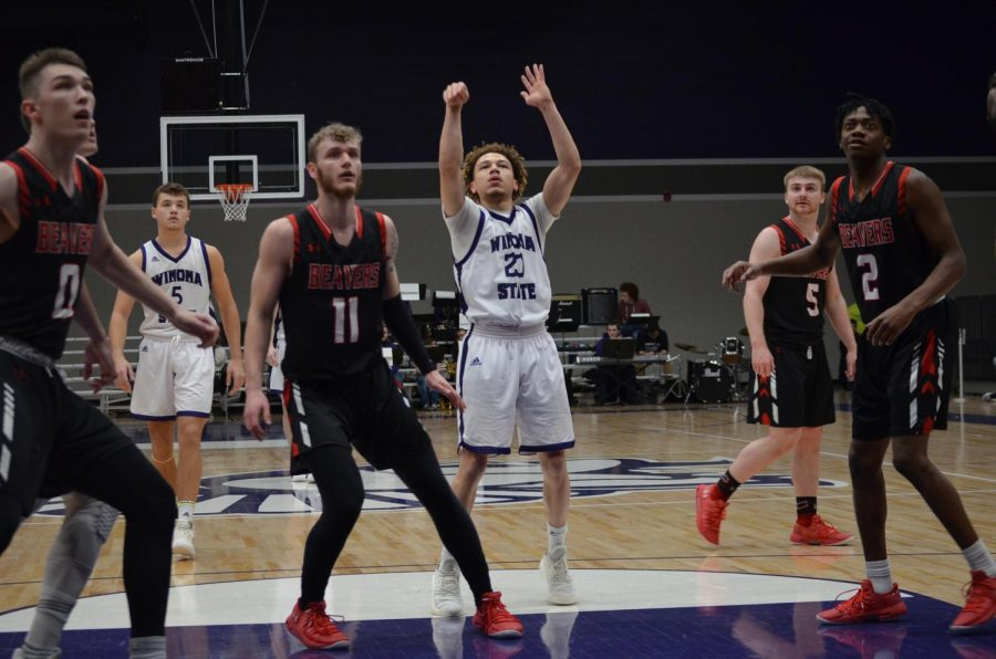Players from Minot State University move to intercept a free-throw from sophomore Devin Whitelow on Friday, Feb. 8 in McCown Gymnasium. The Warriors lost 72-87 on Friday but came back with a win against the University of Mary scoring 84-56.
