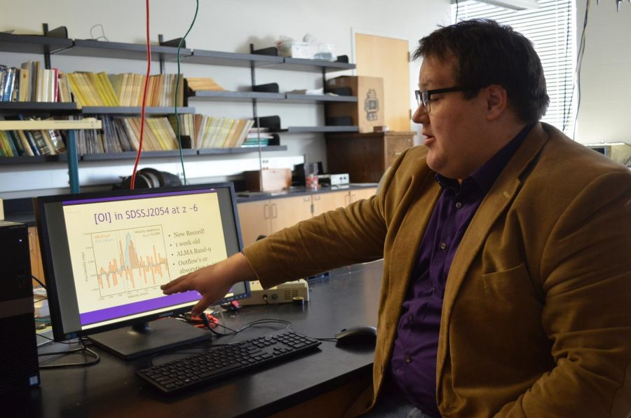 Physics Professor Carl Ferkinhoff and his team were recently awarded the National Science Foundation Career Grant for their research mapping galaxies that existed near the beginning of the universe and range from 7 billion light years away to 13 billion. Pictured above, Ferkinhoff explains how the research is conducted by observing the data they collect.
