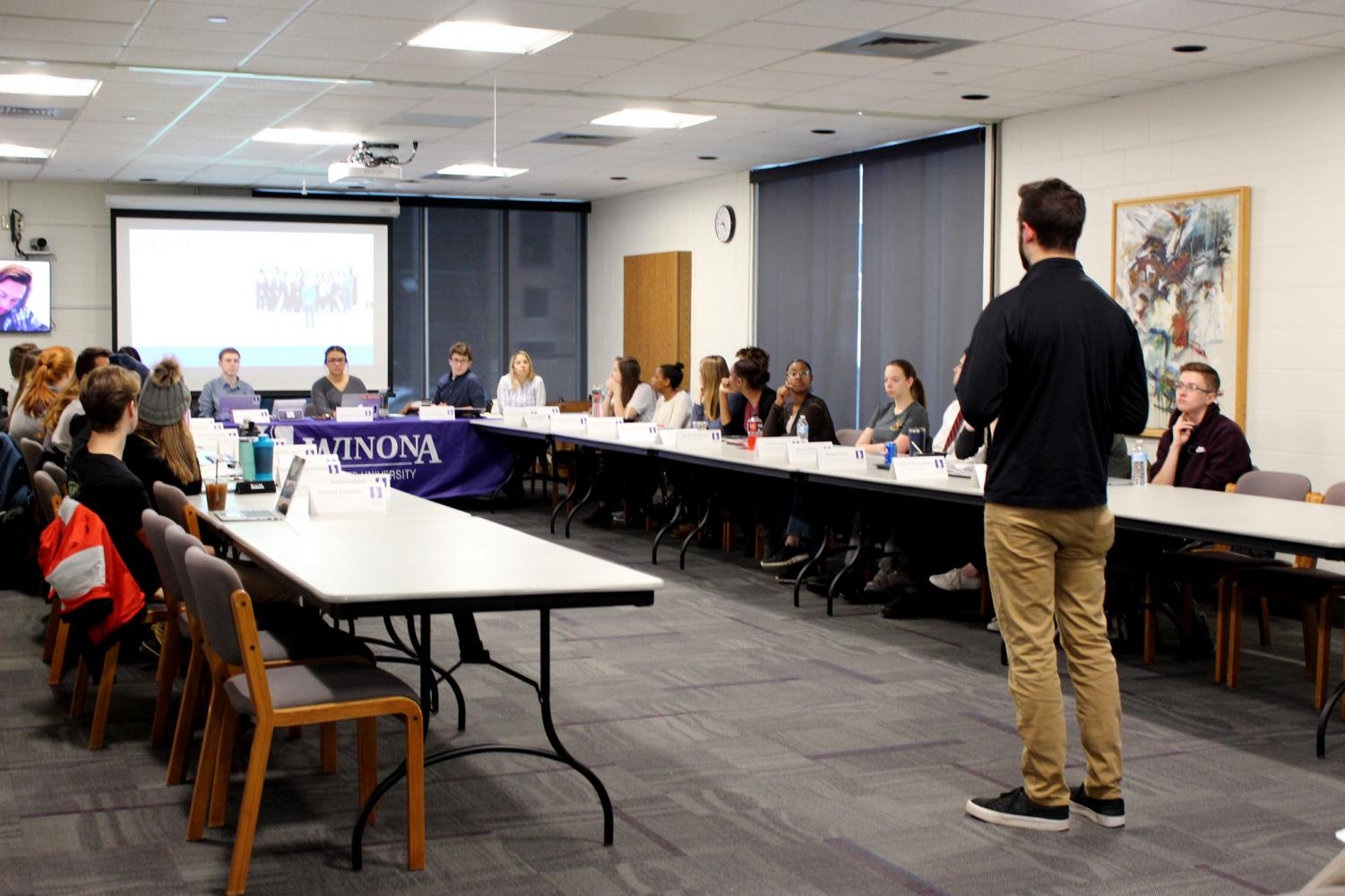 Geoffrey Curry of Pi Sigma Epsilon stands before Student Senate to ask for funds, the fraternity will be attending a business convention in Florida later this year.