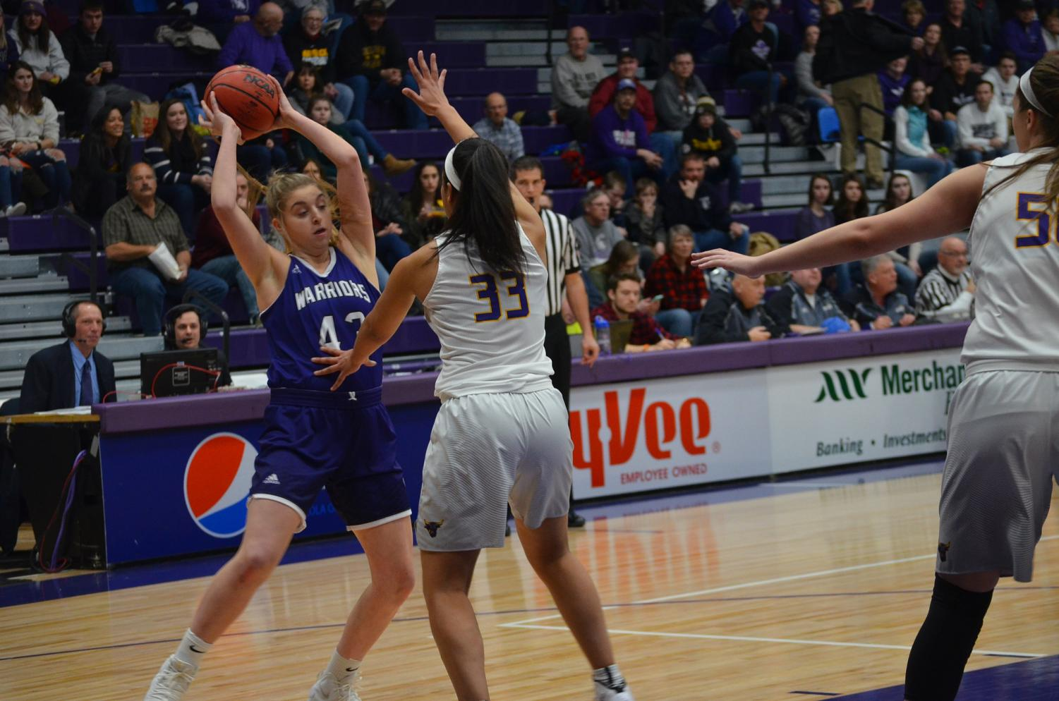 Sophomore Emma Fee attempts to pass to a teammate during a game against Minnesota State University-Mankato on Saturday, Feb. 23 in McCown Gymnasium.