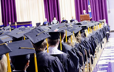 A view from behind shows a graduating class during commencement, due to the new limited seating, graduation ceremonies will have ticketed seating with roughly four seats guaranteed for each graduating senior.
