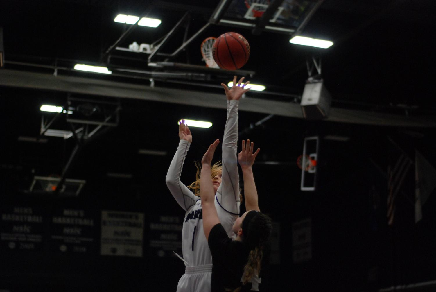Junior Gabie Doud attempts to score against Minot State University during the first round of the NSIC Tournament on Wednesday, Feb. 27 in the McCown Gymnasium. The Warriors won against the Beavers, moving on to the next round where they ended the season with a loss against Minnesota State University Moorhead.