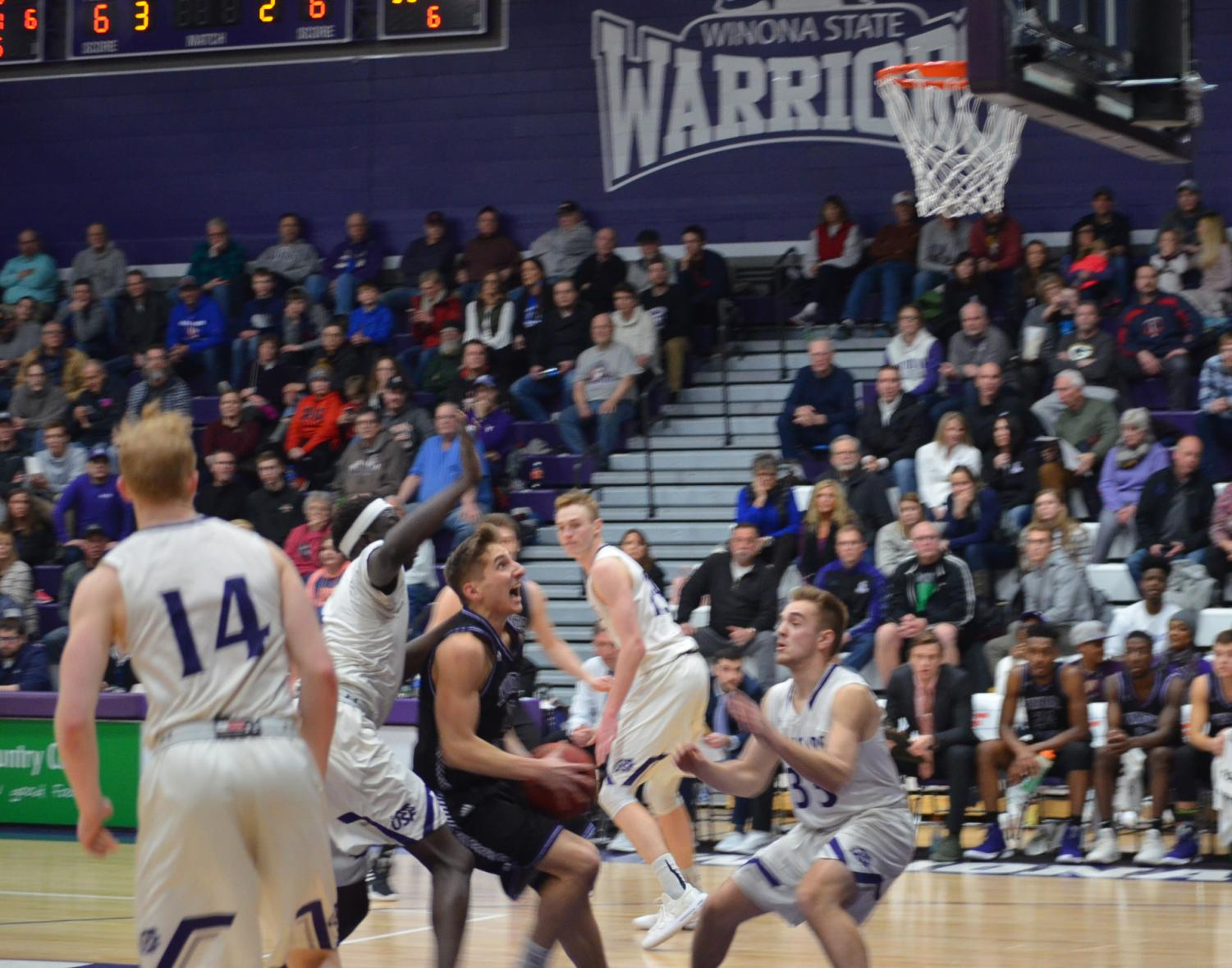 Junior guard Caleb Wagner charges toward the net in an attempt on basket during a game against the University of Sioux Falls in McCown Gymnasium.