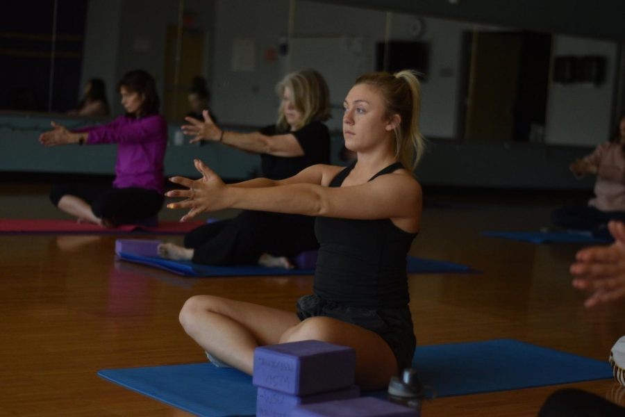 Senior Courtney Meints in Monday's resilience yoga class following instructions by teacher Mollee Sheehan at the Integrated Wellness Center 127.
