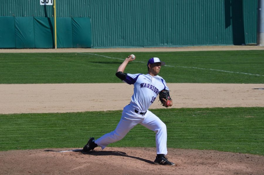 Junior Nathan Looms pitches against the University of Sioux Falls on Friday, April 26 at Loughrey Field. The Warriors played the Cougars in three games over the weekend, coming away with two wins and a loss.