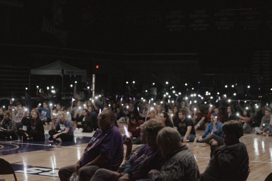 The Winona community holds up light from phones to honor people who died from cancer during the lumiere awards at Relay for Life this past Friday night. The event had games and food, and anyone was welcomed to attend.