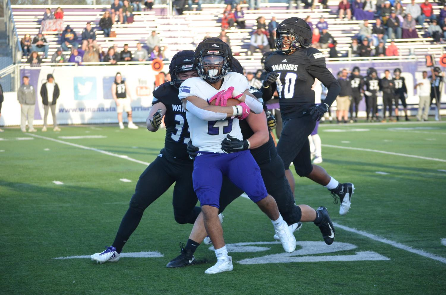 Sophomore running back Sam Santiago-Lloyd attempts to move the play down field during the spring game on Friday, April 26 in the Altra Credit Federal Union Stadium. Santiago-Lloyd played for the offensive team, loosing to the defensive team 81-44.