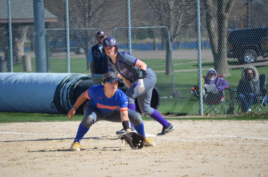 The+Winona+State+softball+team+lines+up+along+the+base+line+to+congratulate+junior+Alison+Nowak+on+her+home+run+hit+against+the+University+of+Minnesota+Duluth+on+Friday%2C+April+19+at+the+Maynard+R.+Johnson+Field.