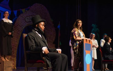 Sophomore Erebi Nyenkan portrays President Lincoln during a dress rehearsal of the spring play