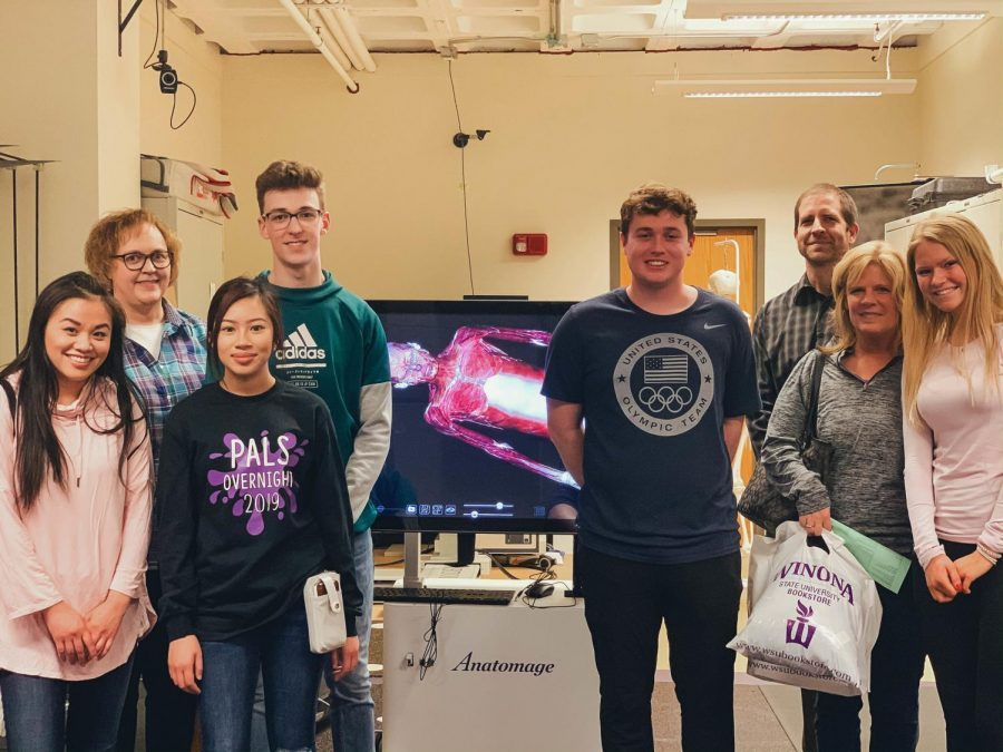 Professor Philip Appicell (third from right) with incoming first-year students and parents while giving a tour in Maxwell Hall during the Choose WSU Days on Monday, April 8.