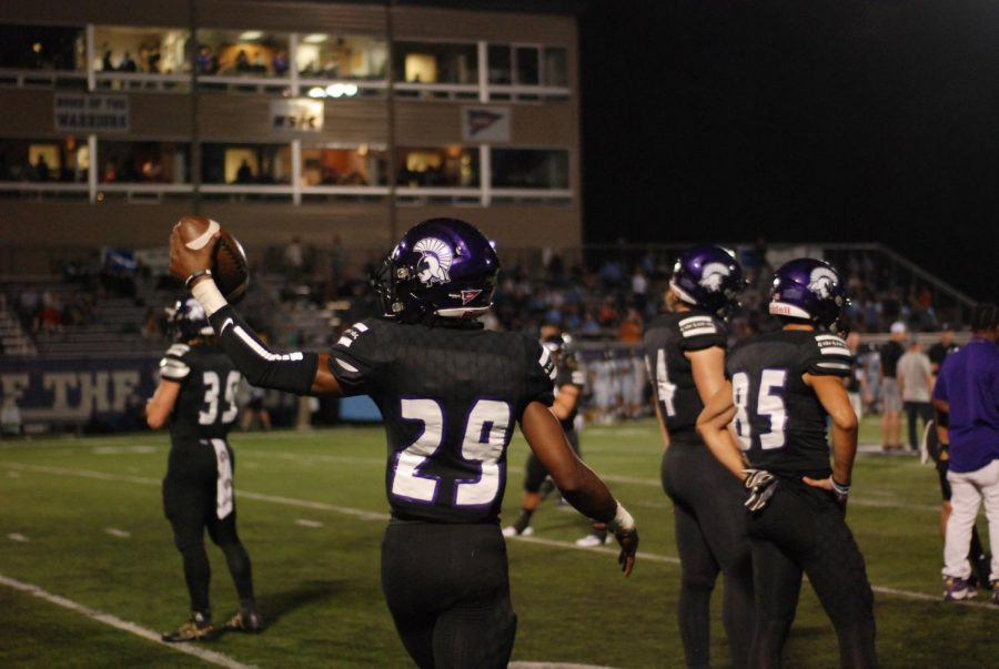 Winona State junior, Javian Roebuck, raises the ball in the air during the post-halftime warm-up on Thursday, Sept. 19 against Upper Iowa University. The Warriors secured their second win of the season against the Peacocks, scoring 28-0 at Altra Credit Federal Union Stadium.