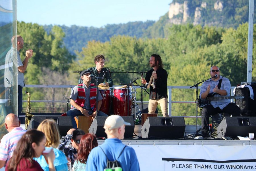 Golpe Tierra, an Afro-Peruvian band from Madison, Wisconsin, encourage the crowd to clap along to the music during Rhythm @ the River on Sunday, Sept. 15. Golpe Tierra performed along with the La Crosse Orchestra during the event at Levee Park.
