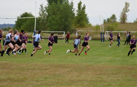 Annika Culver runs down the field during the 2019 All Minnesota rugby tournament on Saturday, Sept. 14 in Otsego, Minnesota. This is the first season the Black Katts will compete in a DI league after moving up from DII last year, the change came after the team struggled to find teams in their division who would play them. The season record is 5-0.
