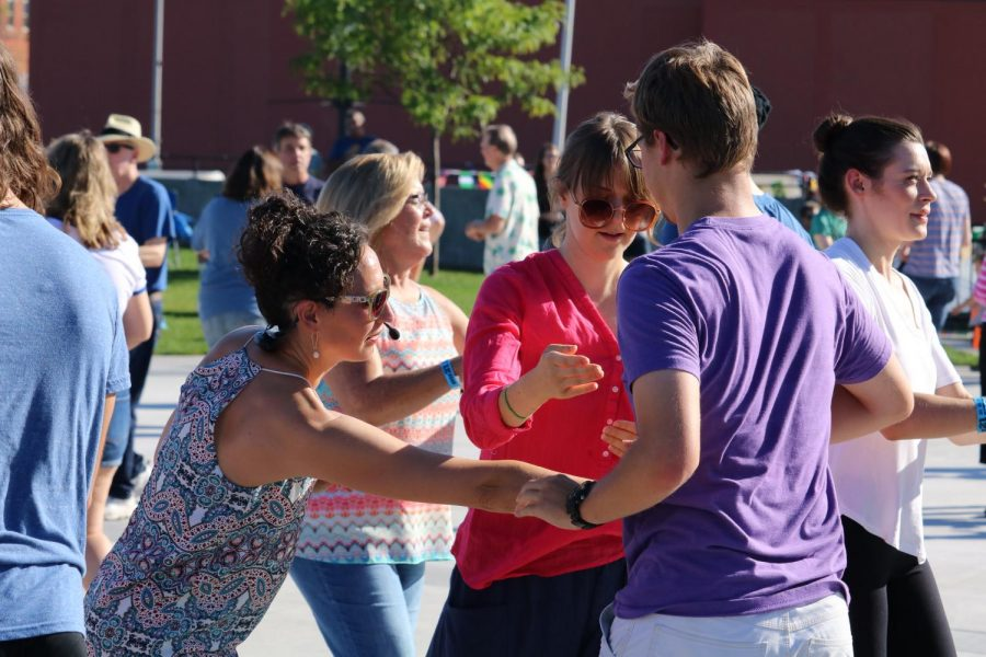 Dance instructor Molly Breitlow gives tips on how to properly spin during a salsa lesson at Rhythm @ the River on Sunday, Sept. 15.