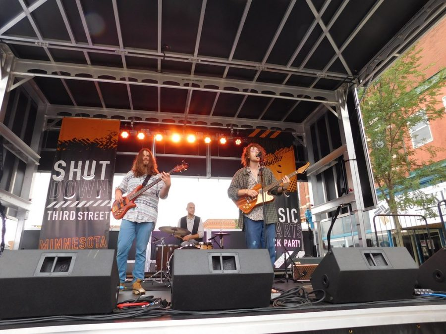 Local+band+Afflatus+played+at+the+main+stage+during+%E2%80%9CShut+Down+Third+Street%E2%80%9D+on+Saturday%2C+Sept.+21.+%E2%80%9CShut+Down+Third+Street%E2%80%9D+went+up+and+down+Third+Street+from+12+p.m.+-+1+a.m.+and+involved+many+local+businesses+and+bands.