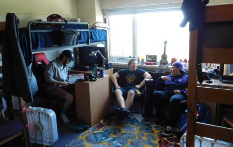 Left to right: Sophomore Zachary Stortz, first year Corbin Starr and Tyler Gliem sit in their dorm room in Sheehan Hall. This is the first year male students have been allowed to live in Sheehan in 50 years.