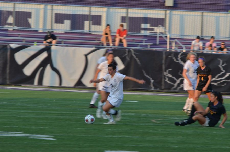 Junior midfielder Missy Greco steals the ball from a Mavericks player during the game against Minnesota State University - Mankato on Friday, Sept. 20. The Warriors lost 0-3 Friday night, and 2-4 on Sunday against Concordia University, St. Paul.