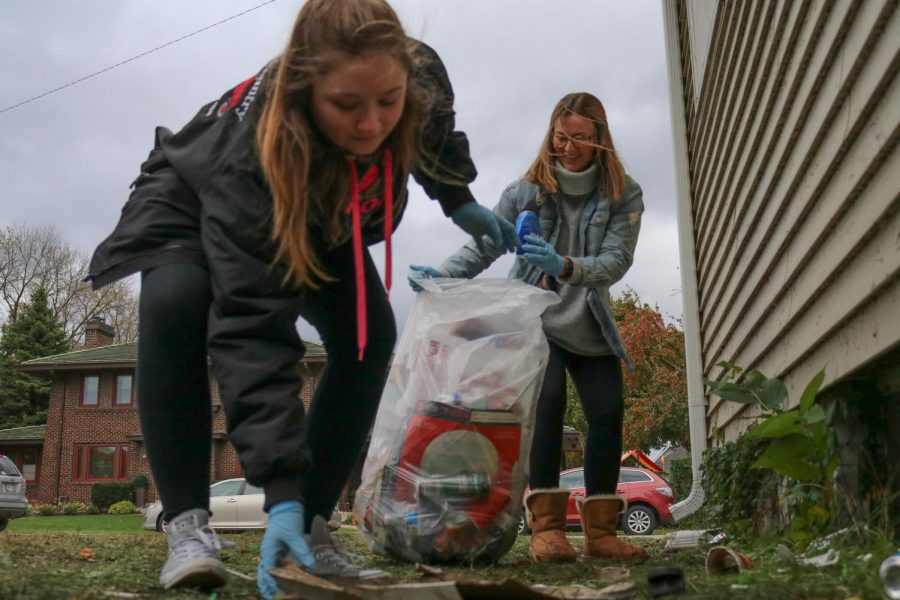 Winona State University students Jordyn Stasiak (left) and Aly Tracey (right) pick up trash during the Winona State Homecoming Clean Sweep, a post-homecoming initiative to clean up the streets surrounding campus. Stasiak and Tracey volunteered with The National Society of Collegiate Scholars, an honor society in which they both are active members.
