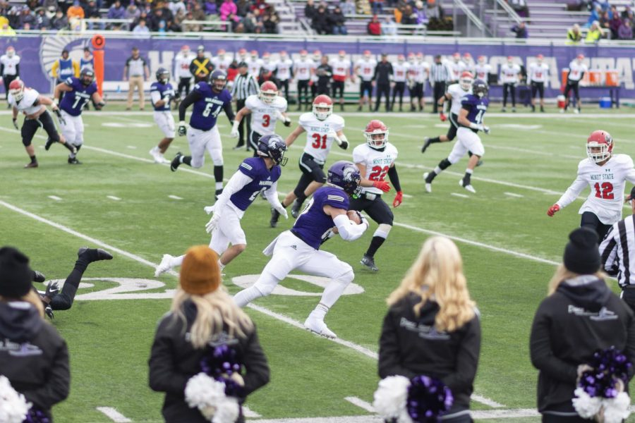 Wide receiver Ethan Wittenburg rushes the ball  downfield amidst a play against the Minot State Beavers for the 2019 Homecoming game. The game was delayed until Sunday, Oct. 13 due to weather.