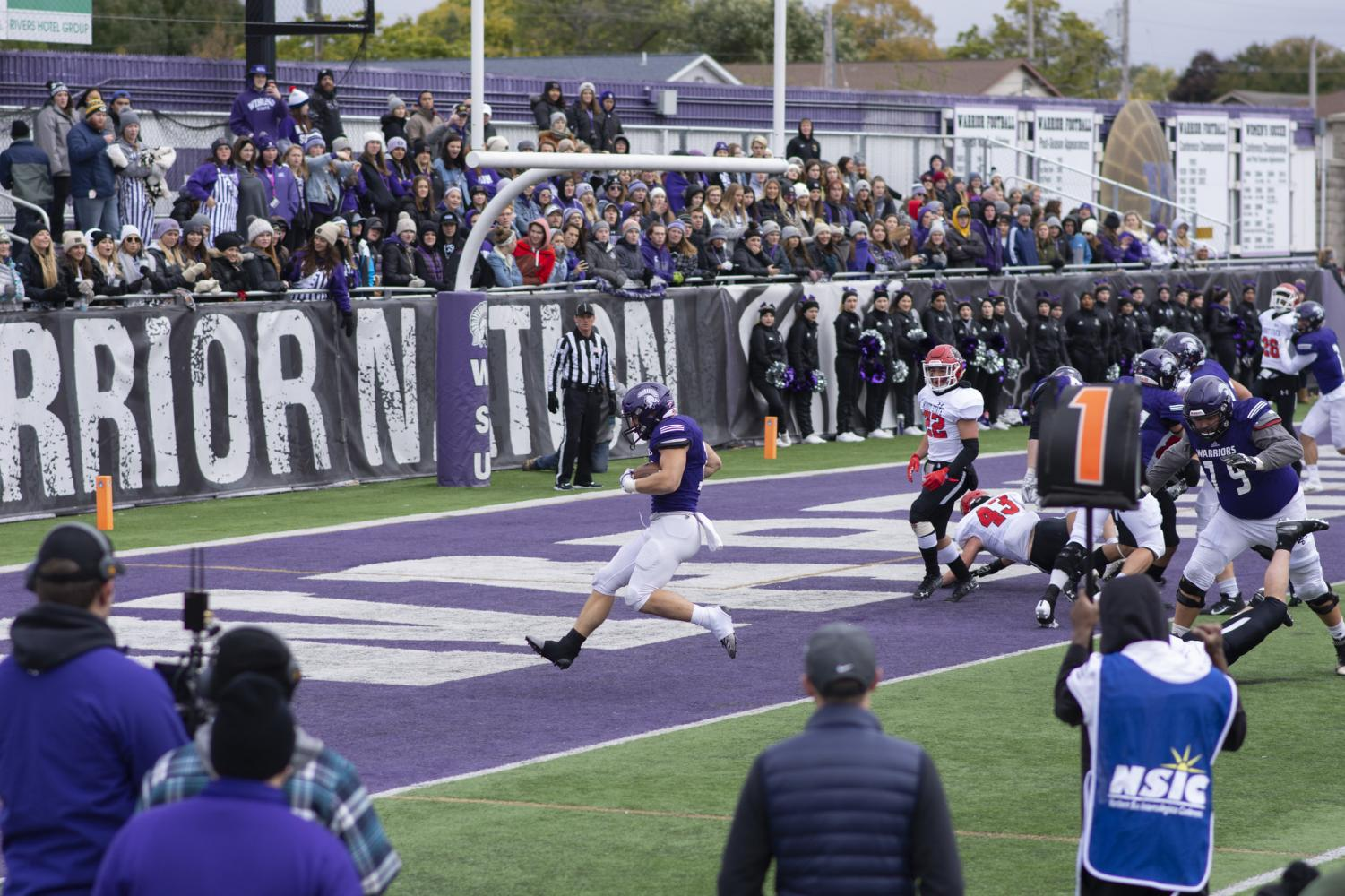 Landon Jacobson scores a touchdown in the second quarter with an unexpected one-yard run. The Warriors beat the Minot State Beavers 49-3 at the Altra Federal Credit Union Stadium on Sunday, Oct. 13.