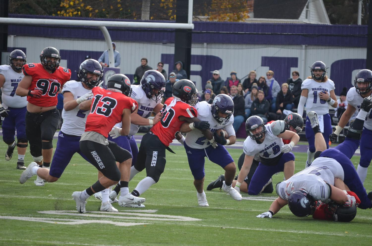 Sam Santiago-Lloyd, a junior running back, pushes through the defensive line against St. Cloud State University on Saturday, October 26 in Altra Federal Credit Union Stadium.
