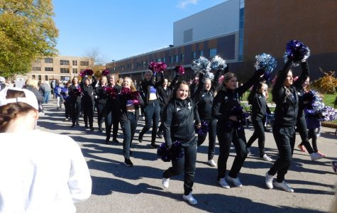 The WSU Dance Team followed behind the football team during the Game Day Experience on Saturday, Oct. 26. Their pep before the game helped push the football team to win against St. Cloud State University.