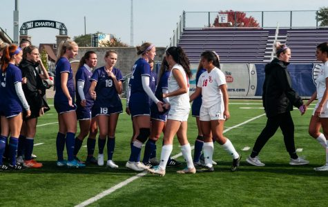 The Winona State soccer team congratulates players from Minot State University after their game on Sunday, Oct. 27 at Altra Federal Credit Union Stadium where the Warriors won 3-0.
