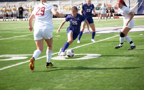 Junior Camryn Cadiz kicks the ball out of the way in mid-field during Sunday's game. The Winona State Warriors won 2-0 against Minnesota State University Moorhead at Maxwell Field's Altra Federal Credit Union Stadium. The game began at 1 p.m.